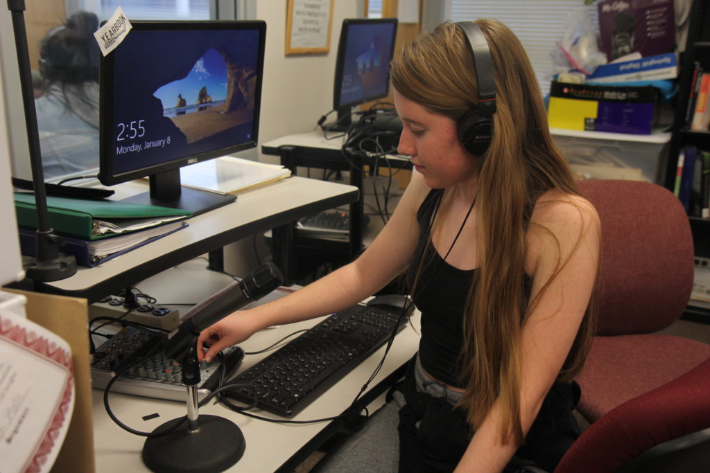 Rachel Ely works on her show.